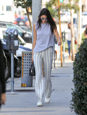 Kendall Jenner completed her cool ensemble with a pair of striped pants, also by Sally LaPointe.