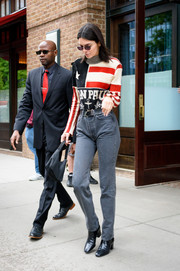 Kendall Jenner sealed off her outfit with a pair of black ankle boots by Givenchy.