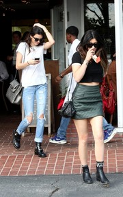 Kendall Jenner blended in with the crowd in a plain white tee while out and about at Fred Segal.