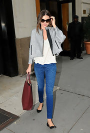 Miranda Kerr took a walk on the wild side in a pair of blue leopard print skinny jeans.