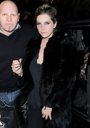 Kesha has never been one to shy away from bold looks like this black fur coat, which the singer wore while out in London.