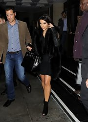 Kim's ankle boots were extra-cute, thanks to the surprising peep-toe silhouette.