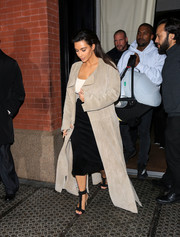 Kim Kardashian teetered on a pair of black T-strap stilettos while out and about.