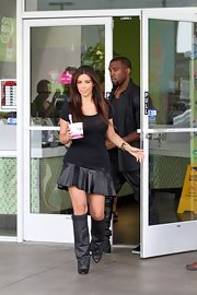 Kim Kardashian looked edgy and stylish in her Givenchy knee-high leather boots while out for frozen yogurt.