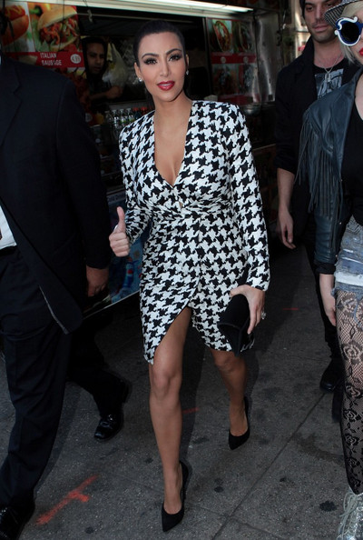 Erika  Pelt on Kim Kardashian Shows Off Some Cleavage And Leg In A Houndstooth Wrap