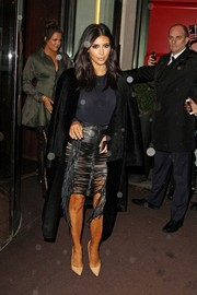 Kim Kardashian was equal parts sultry and edgy in a fringed black see-through leather skirt by Magda Butrym during the Hairfinity launch.