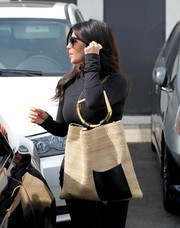 Kim Kardashian was spotted at a hair salon carrying an oversized tweed tote by Celine.