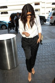 Kim Kardashian was spotted at LAX looking tres chic in a white wrap top.