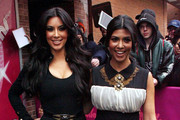 Kim and Kourtney Kardashian leave 'Live with Regis and Kelly' before changing outfits to appear on 'The Wendy Williams Show'.