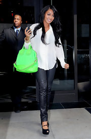 La La Anthony's neon-green leather tote added a dose of brightness to her look.