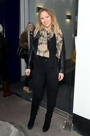 Kimberley Walsh opted for a tan patterned scarf to accessorize her leather jacket while at Heart FM.