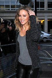 Kimberley Walsh cozied up in a thick gray cardigan during a visit to BBC Radio 1.