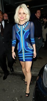 Kimberly Wyatt opted for a geometric print dress for her look while taping 'Celebrity Justice' in London.