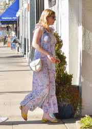 Kirsten Dunst looked summery in a lilac maxi dress with ruffle straps and a smocked neckline while out and about in LA.