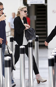 Kristen opted for casual suede clogs while traveling overseas.