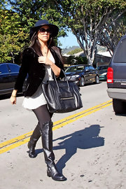 Kourtney Kardashian's boots were a girly touch to her outfit thanks to their ruffled detail.
