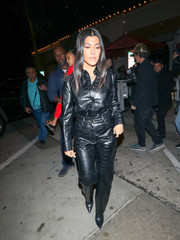 Kourtney Kardashian channeled her inner rockstar in a black vegan-leather button-down by Nanushka while enjoying a night out.