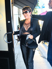 Kris Jenner accessorized with a chic Dior Saddle  bag, in black velvet, while out in LA.