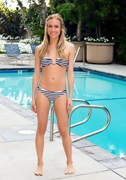Kristin showed off her toned figure with a nautical striped bandeau bikini.