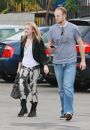 Dakota Fanning was spotted on the set of 'The Runaways' in acid-wash skinny jeans paired with tough-chic black combat boots.