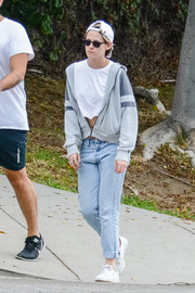 Kristen Stewart layered a gray zip-up hoodie over a white crop-top for a day out in LA.