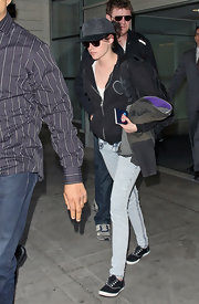 "Kristen stepped out in a pair of acid washed ""Patience"" five pocket, skinny jeans with dark blue top-stitching."