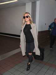 Kristin Cavallari lugged along a simple black rollerboard while making her way through the airport.