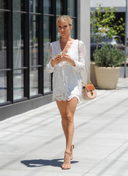 Kristin Cavallari lengthened her gorgeous pins with a pair of nude skinny-strap heels.