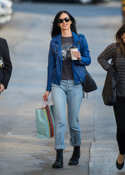 Krysten Ritter topped off her jeans with a blue leather biker jacket.