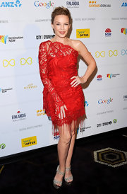 Kylie Minogue paired her red dress with platform sandals.