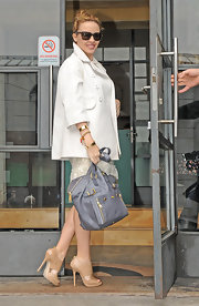 "Kylie carried a blue-gray leather ""Downtown Tote"" with gold hardware and a double strapped top handle."