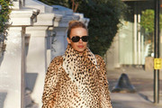 Singing sensation Kylie Minogue is seen leaving her home for the London Palladium, the singer is then seen leaving the Palladium and returning home.