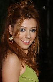Alyson Hannigan paired her messy updo with decadent gemstone earrings.