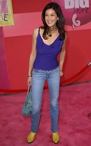 Teri Hatcher went for a colorful look in a purple ruffled tank.