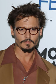 Actor Johnny Depp sported spiked hair at the premiere of The Libertine.