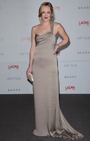 Dakota looked simply statuesque in this dove gray one-shoulder gown.