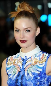 Holliday Grainger opted for berry lips to match her high-fashion ensemble for the London Film Fest.