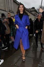 Emily Ratajkowski made her way to the Topshop Unique fashion show wearing a chic electric-blue wool coat.