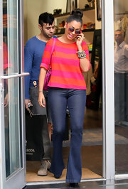 La La Vazquez teamed her trendy striped top with flared trouser jeans.