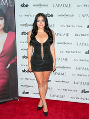 Ariel Winter burned up the red carpet in a little black sequin dress and a lace-up front during the LaPalme Magazine fall cover party.