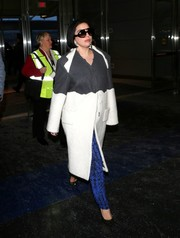 Lady Gaga sealed off her chic airport outfit with sparkly black pumps.