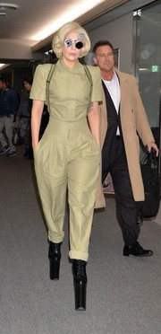 Lady Gaga completed her travel outfit with a pair of khaki trousers and her signature platform boots.