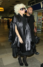 Lady Gaga never misses an opportunity to show off her unique style. She traveled through the airport wearing platform pumps.