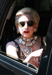 With her perfectly coiffed bob and oversize stud earrings, this could almost be First Lady Gaga!