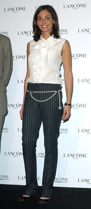 Ines added a feminine touch to her look with a Chanel beaded chain belt.
