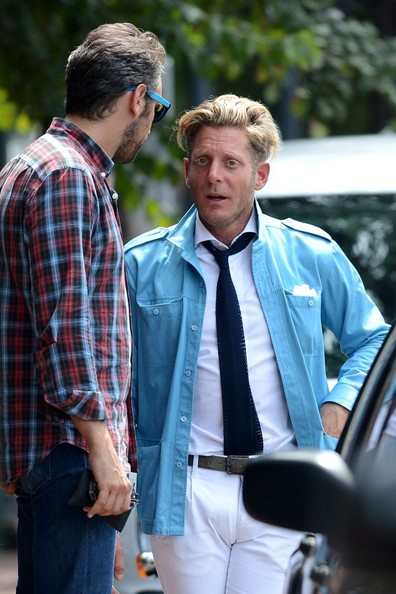 Lapo Elkann finished off his smart ensemble with a navy knit tie.