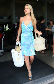 "The always cool and casual Ms. Larter totes the $1,895 ""Downtown"" bag through LAX."