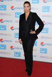 Eva Longoria showed off a little masculine flair with a tailored pant suit and sleek bun.