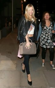 Laura Whitmore exuded an edgy vibe in a black leather moto jacket and skinny jeans while out in London.