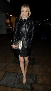 Laura Whitmore was spotted on Oxford Street looking chic in nude platform sandals and a leather coat.